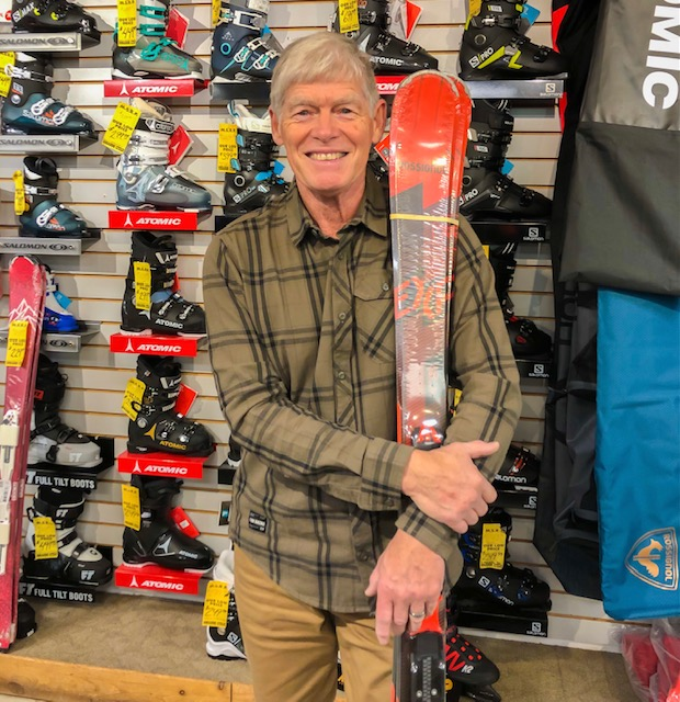 The owner of College Sports, Bob Hinton standing with a set of skis